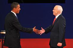 Barack Obama and John McCain greet each other at their Oct. 7 Nashville debate. Though it hasn't played a major role in their debates, the candidates differ sharply on education.