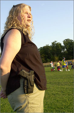 Meleanie Hain  wears her weapon, a loaded Glock 26, in a holster to her 5-year-old daughter's soccer game on Sept. 23 at Optimist Park in Lebanon, Pa. Hain testified at the Tuesday hearing that she did not intend to intimidate anyone but felt she had to carry the gun openly because warm-weather clothing made it difficult to hide a firearm.