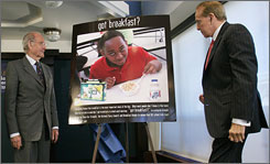 Former senators George McGovern, left, and Bob Dole, unveil a poster for their new campaign to raise awareness for school breakfast programs.