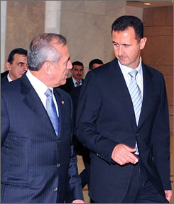 Syria and Lebanon have agreed to establish diplomatic ties. Here, Syrian President Bashar Assad, right, is seen with Lebanon President Michel Suleiman in Damascus, Syria, on Aug. 14.