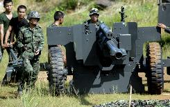 Thai soldiers prepare their artillery at a base near the Thai-Cambodian border after a clash between Thai and Cambodian soldiers broke out in Sisaket province, northeastern Thailand.