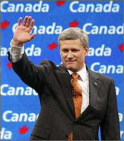 Conservative Party leader and Canadian Prime Minister Stephen Harper gestures to supporters at his election night headquarters in Calgary on Tuesday night. Harper on Wednesday declared victory in Tuesday's general election, which saw his ruling Conservatives strengthen their grasp on power.