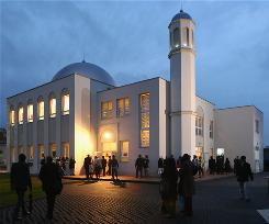 People arrive at the Khadija mosque shorlty before its official opening ceremony Oct. 16 in Berlin.
