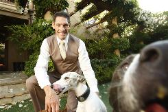 Gary Michelson, with whippet Gracie and pit bull Rufus, wants to prevent unwanted litters  and he's putting his money where his heart is.