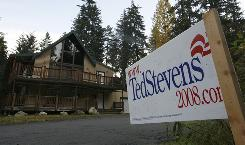 A campaign sign stands across the street from the chalet of Sen. Ted Stevens, R-Alaska. Stevens is on trial in Washington, D.C., on corruption charges involving financial disclosure statements and is running for re-election.