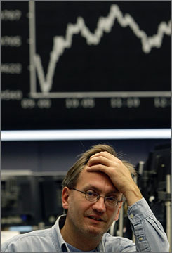A trader at the Frankfurt stock exchange reacts in front of the Dax board on Thursday.