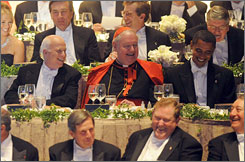 New York Cardinal Edward Egan, center, laughs with presidential candidates John McCain, left, and Barack Obama at a New York City charity dinner Thurday.