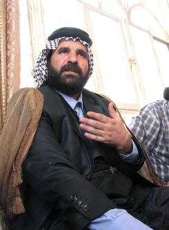 Sheik Nabil Sagban, head of the Al-Fatla tribe, sits in a tribal hall that was recently raided by police. 