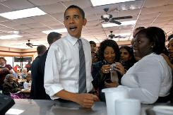 Barack Obama orders chicken at Cape Fear Barbeque & Chicken in Fayetteville, N.C. on Sunday, before making his way to the Crown Coliseum in Fayetteville.