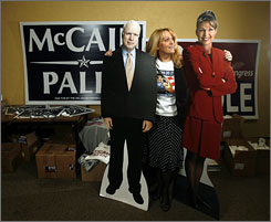 Oklahoma County GOP Chairwoman Pam Pollard sizes up cutouts of John McCain and Sarah Palin on Monday.