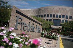A new report indicates that Freddie Mac paid a firm to kill a bill that would have ordered trims for the mortgage giant and its sister company, Fannie Mae. Here, Freddie Mac's head office in McLean, Va., is seen.