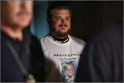 Robert Puffinburger waits to talk at a news conference in Las Vegas early Sunday. Robert's son Cole Mason Puffinburger, who was kindapped on Oct. 15, was found alive Saturday in Las Vegas.