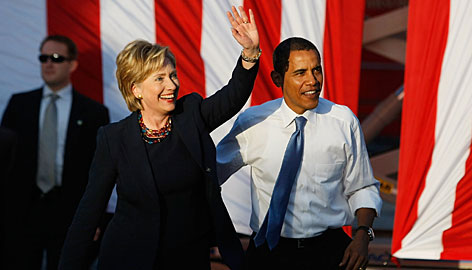 Hillary Rodham Clinton joins Barack Obama at a rally Monday in Orlando. About 50,000 people attended