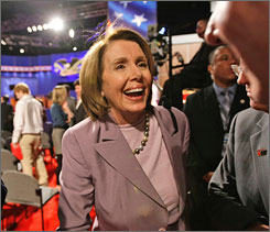 House Speaker Nancy Pelosi, D-Calif., says House Democrats are pouring money into races that they now feel they can win. Here, Pelosi is seen arriving for the Oct. 15 presidential debate at Hofstra University in Long Island, N.Y., between Democratic candidate Barack Obama and Republican candidate John McCain.
