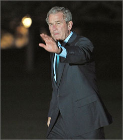 President Bush, seen here on Monday returning to the White House from a meeting in Louisiana, is hosting an international aid summit on Tuesday.