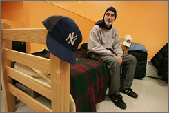 "Thomas Malinowski, 48, who lived on New York's streets for 13 years, sits on his cot in the ""Safe Haven"" shelter in Manhattan on January 21, 2007."