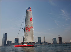 The Virgin Money sails down the Hudson River in New York before setting off for an attempt to break the trans-Atlantic record.