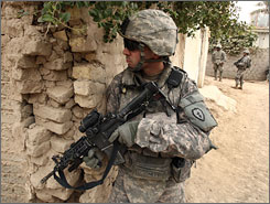 U.S soldiers patrol in a village near Baqouba in Diyala province, about 40 miles northeast of Baghdad, on Wednesday.