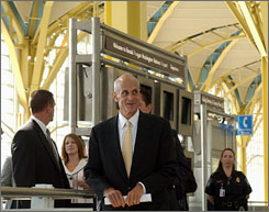 Homeland Security Secretary Michael Chertoff at Reagan National Airport outside Washington in August, 2007, during a previous announcement involving the much-delayed Secure Flight passenger-screening program.