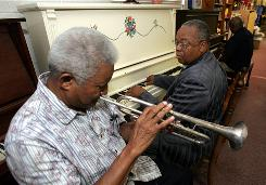 Frank Hart, 72, who recently picked up a trumpet after 45 years, and the Rev. James Brown, 61, practice a song they will play for a program at the First Baptist Church in Jacksonville, N.C. Music is one of the ways Brown encourages members to keep their minds supple.