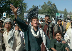 Demostrators shout anti-Taliban slogans during a protest in Laghman province, Afghanistan, of this week's execution of 26 young men.