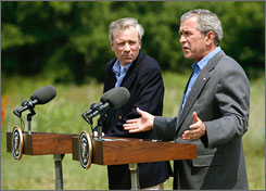 President Bush plans to meet Friday with NATO Secretary-General Jaap de Hoop Scheffer to take steps toward bringing Albania and Croatia into the international agency. Here, the two are seen speaking to reporters after a meeting at Bush's ranch in Crawford, Texas, in May 2007.