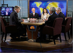 Moderator David Gregory, left, speaks with financial reporters from both television and print outlets during an August taping of NBC's Meet the Press.