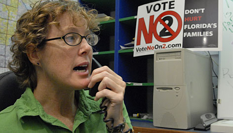 Phone bank volunteer Erika Spohrer, 36, in St. Petersburg, Fla., contacts voters to urge them to oppose Amendment 2.