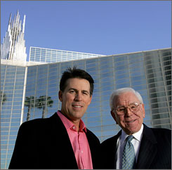 Robert A. Schuller, left, and his father, Robert H. Schuller, outside the Crystal Cathedral in 2006.