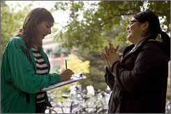University of Oregon student Jessica Ortiz, right, signs up Raquel Levine in a voter-registration drive Oct. 2 in Eugene, Ore. Both campaigns insist they are not taking the state for granted.