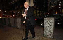 Former Chicago police Lt. Jon Burge arrives at the Dirksen Federal Building in Chicago on Monday for his arraignment hearing. Burge, who is at the center of allegations that suspects were tortured into confession, pleaded not guilty to charges of obstruction of justice and perjury.