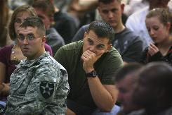 Sgts. Robon McKay, left, and Brian Watt listen to information about identifying and dealing with post-traumatic stress disorder during a presentation for soldiers and families from the 4th Stryker Brigade Combat Team 2nd Infantry Division at Fort Lewis, Wash., in August.