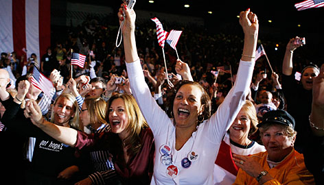 People cheer Monday as Democrat Barack Obama speaks at the Canton Civic Center in Ohio. Nearly 5,000 people attended.