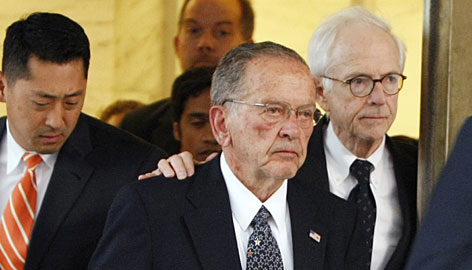 Sen. Ted Stevens, R-Alaska, and his attorney Brendan Sullivan leave federal court in Washington on Monday after a guilty verdict was returned by the jury at his trial.