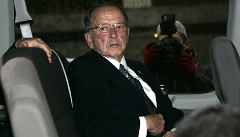 Republican Sen. Ted Stevens waits Monday in a van outside the federal courthouse in Washington.