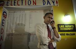 U.S. Democratic presidential candidate Illinois Senator Barack Obama talks on the phone with a registered voter as he pays a visit to one of his campaign offices to greet volunteers and help make phone calls to gather votes on Oct. 27 in Pittsburgh, Pa.