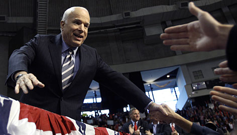 Republican presidential candidate John McCain greets supporters as he arrives at a rally at The Crown Center in Fayetteville, N.C., on Tuesday.