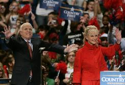 Republican presidential candidate Sen. John McCain, R-Ariz., and his wife Cindy, greet supporters as they take the stageon Oct. 27 during a campaign rally in Pottsville, Pa.