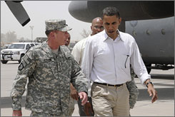 Gen. David H. Petraeus heads to a Blackhawk helicopter with Barack Obama at Baghdad International Airport July 21.