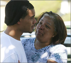 Emma Melton, aunt to Julian Alexander, consoles her other nephew Alfred Bell Jr. near the home where Alexander was shot in Anaheim, Calif., on Tuesday. Alexander, 20, was killed by police in a case of mistaken identity, police said.