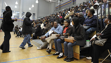 Early-bird voters fill in the gym at the Adamsville Recreation Center in Atlanta on Wednesday, where some waited hours.