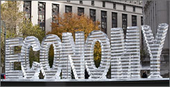 "Two artists Wednesday installed a 1,500-pound ice sculpture that spelled the word ""economy"" in Manhattan's financial district."