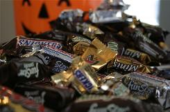 """Fun Size"" and ""Mini"" candies in front of a Halloween bucket in New York."