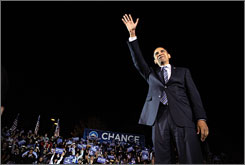 Democratic presidential candidate Barack Obama waves to supporters Friday in Highland, Ind. Both candidates traveled the Midwest in this final homestretch of the battle for the White House. 