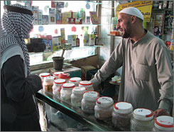 Sheik Fuad Abu Amir, owner of a Baghdad herbal-medicine shop, consults with a patient. Iraqis increasingly seek herbal treatment as pharmacies are filled with unreliable, unlicensed imports.