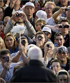 Students at the University of Scranton in Pennsylvania snap John McCain's photo Sunday.