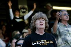 A John McCain supporter prays during a sermon at The Call, Fast and Prayer Service at Qualcomm Stadium in San Diego, Nov. 1. The central theme of the rally was for family values and a call to support California Proposition 8, which would ban gay marriage.