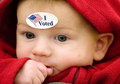 Acer Bearman-Drummond wears a sticker after voting with his mother, Jessica Bearman, at the Latah County Fairground in Moscow, Idaho.