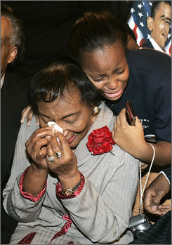 Christine King Farris, sister of civil-rights leader Martin Luther King Jr., is embraced by her grandaughter after a cable news channel announce democratic presidential candidate Barack Obama as the winner at Ebenezer Baptist Church in Atlanta.