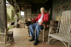 The Rev. Billy Graham, one of America's most acclaimed evangelists, sits on the porch of his mountain cabin in Montreat, N.C., in 2005.